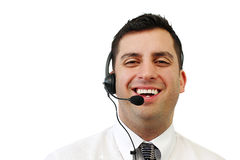 Smiling Customer Service Man. A smiling handsome man wearing a headset isolated over white Stock Image