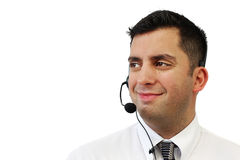 Smiling Customer Service Man. A smiling handsome man wearing a headset isolated over white stock images