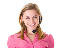 Smiling customer service operator, isolated. Attractive female customer service assistant in pink shirt and with huge smile on her face, studio shoot isolated on Stock Photo