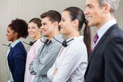 Smiling Customer Service Representative Standing Stock Images