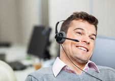 Smiling Customer Service Representative Wearing Royalty Free Stock Photo
