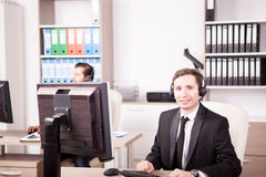 Smiling Customer service support working in the office Stock Images