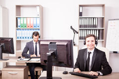 Smiling Customer service support working in the office Royalty Free Stock Photos