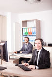 Smiling Customer service support working in the office Royalty Free Stock Images