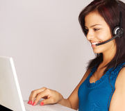 Smiling customer service woman Stock Photo
