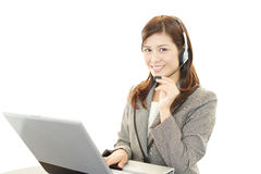 Smiling customer services operator Stock Photo