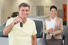 Smiling customer showing his new car key Royalty Free Stock Image