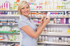 Smiling customer showing a medicine Stock Photography