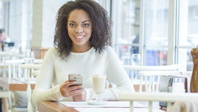 Smiling customer sitting at her table stock video footage