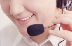 Smiling customer support operator Royalty Free Stock Photos