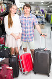 Smiling customers near suitcases Royalty Free Stock Image