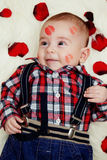 Smiling cute baby boy with lipstick on his face Royalty Free Stock Photography