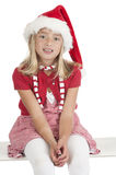 Smiling cute blond girl with christmas hat Royalty Free Stock Photography