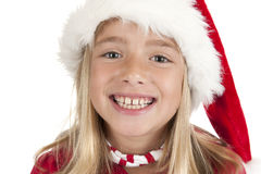 Smiling cute blond girl with christmas hat Royalty Free Stock Photos