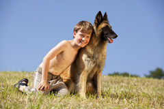 Smiling cute boy with Belgian shepherd Stock Images