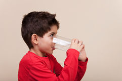 Smiling cute boy drinking water Royalty Free Stock Photography