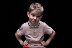 Smiling cute boy with hands on hips Stock Photo