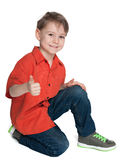 Smiling cute boy with his thumb up Stock Images