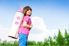 Smiling cute boy wearing carton rocket toy Royalty Free Stock Image