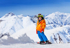 Smiling cute boy wearing ski mask, helmet skiing Royalty Free Stock Photography