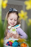 Smiling cute child with easter eggs and plush bunny. Easter Royalty Free Stock Photo