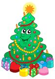 Smiling cute Christmas tree with gift Stock Images
