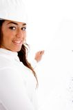 Smiling cute female engineer holding blue prints stock image