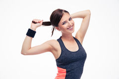 Smiling cute fitness woman holding her hair in ponytail Stock Photography
