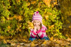 Smiling cute girl against the leaves Stock Image