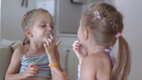 Cheerful girl at mirror stock video