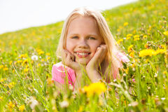 Smiling cute girl holding face with two hands royalty free stock photos