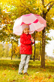 Smiling cute girl holding umbrella under rain Royalty Free Stock Photos