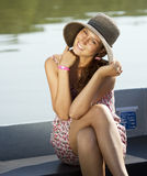 Smiling cute girl near a lake Stock Photos
