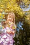 Smiling cute girl posing looking at camera Royalty Free Stock Photography