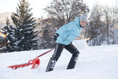 Smiling cute girl pulling sled Stock Photography