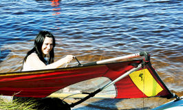 Smiling cute girl raises a sail Royalty Free Stock Photography