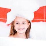 Smiling cute girl is taking a bath Stock Images
