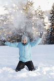 Smiling cute girl throwing snow Royalty Free Stock Images