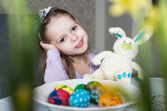 Smiling cute kid with easter eggs and plush bunny. Easter Stock Photography