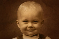 Smiling cute kid sepia royalty free stock photography