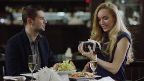 Smiling cute lady getting a present to valentines day stock footage