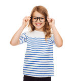Smiling cute little girl with black eyeglasses Stock Photos