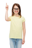 Smiling cute little girl in black eyeglasses Stock Image