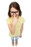 Smiling cute little girl in black eyeglasses Royalty Free Stock Images