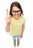 Smiling cute little girl in black eyeglasses Royalty Free Stock Photos