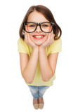 Smiling cute little girl in black eyeglasses Royalty Free Stock Photo