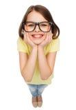 Smiling cute little girl in black eyeglasses Royalty Free Stock Photo