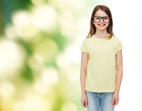 Smiling cute little girl in black eyeglasses Royalty Free Stock Photos