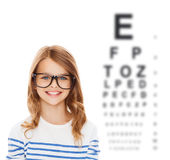 Smiling cute little girl with black eyeglasses Stock Photography