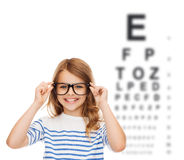 Smiling cute little girl with black eyeglasses Stock Photo